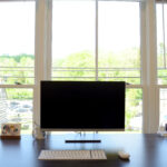 Computer monitor on a coworking office desk